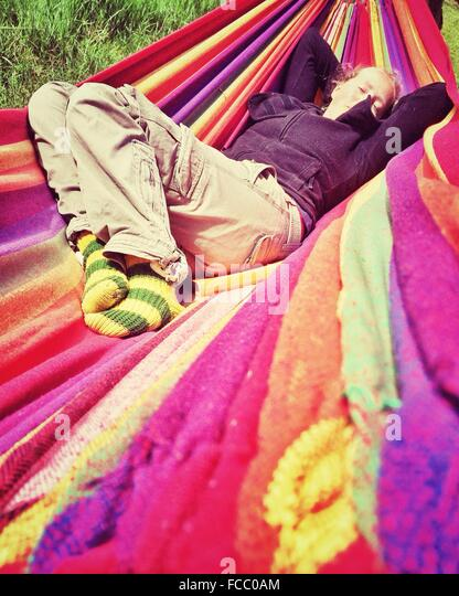 Woman Relaxing In A Hammock - Stock Image