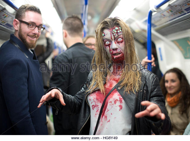 File photo dated 08/10/16 of a woman dressed as a zombie taking the tube in central London on World Zombie Day. - Stock Image