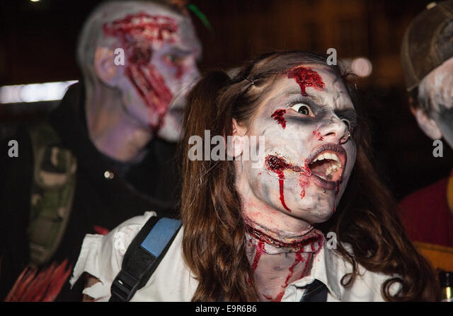 Bristol, UK. 31st October, 2014. Hundreds turned out dressed as zombies and covered in fake blood at Bristol's - Stock Image