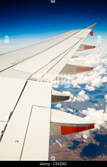 View of jet aircraft wing above the clouds. - Stock-Bilder