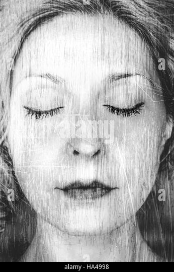 artistic portrait of the young woman with eyes closed - Stock-Bilder