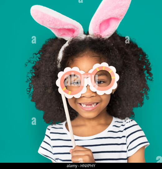 African Descent Little Girl Bunny Ears Concept - Stock Image