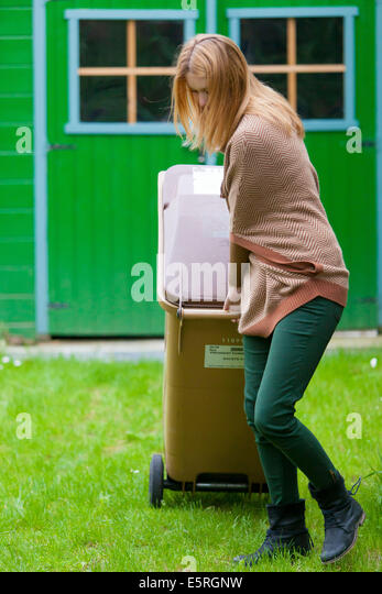 Brown container for waste that can not be recycled. - Stock Image