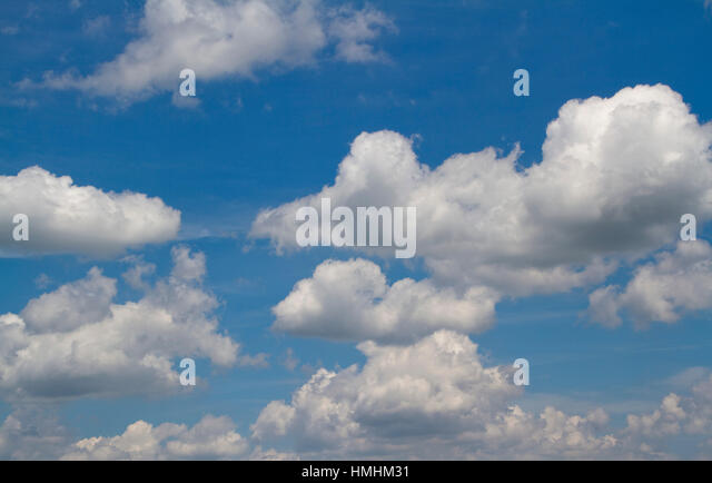 Fluffy clouds and blue sky ... a nice day - Stock Image