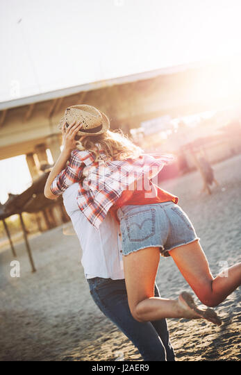 Truly happy playful couple in love  having fun at beach - Stock Image