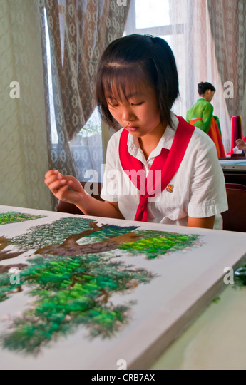 Girl practicing calligraphy, one of the selected children in the Children's Palace, Pyongyang, North Korea, - Stock Image