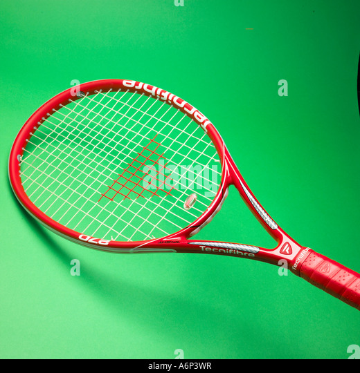 tennis raquet on a green background facing left - Stock Image
