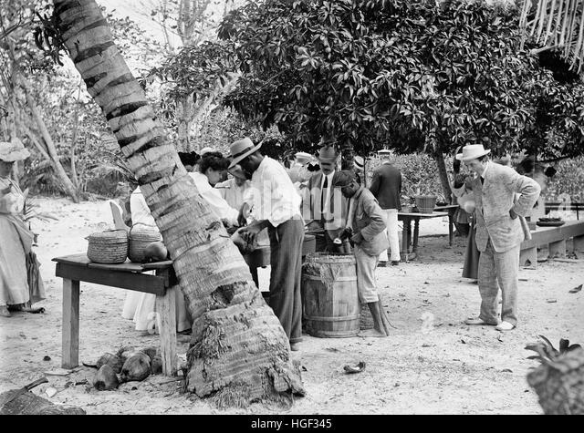 Eating Coconuts, Bahamas, circa 1906 - Stock Image