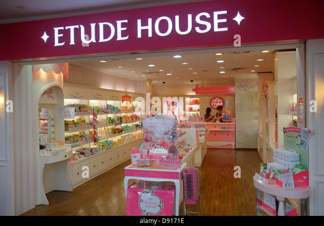Singapore Bugis Junction shopping front entrance Etude House beauty aides skin care - Stock Image