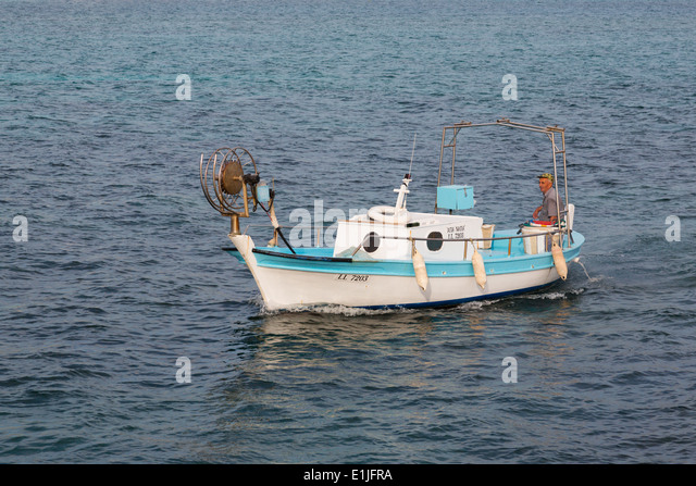 Cypriot fishing boat coming into Ayia Napa harbour after a days fishing, - Stock Image