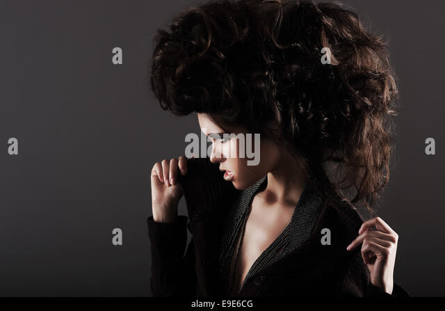 Updo. Eccentric Woman with Styled Curly Hairs - Stock Image