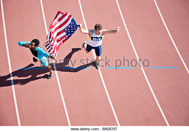 Runner celebrating on track with American flag - Stock Image
