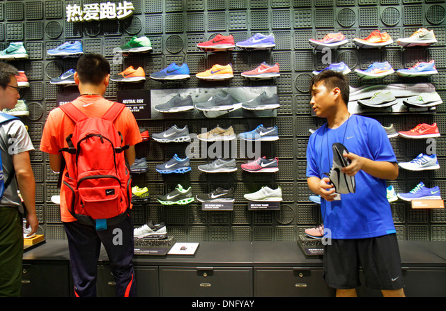 Beijing China Chaoyang District Sanlitun Village South North Piazza Deck shopping mall center centre Nike Store - Stock Image