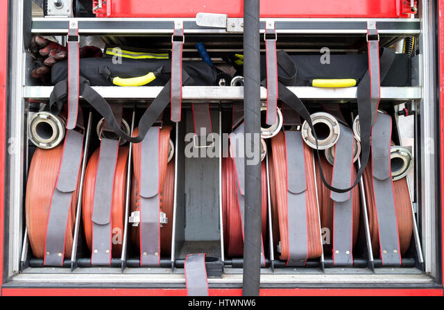 fire hoses with Storz couplings on board a fire engine - Stock Image