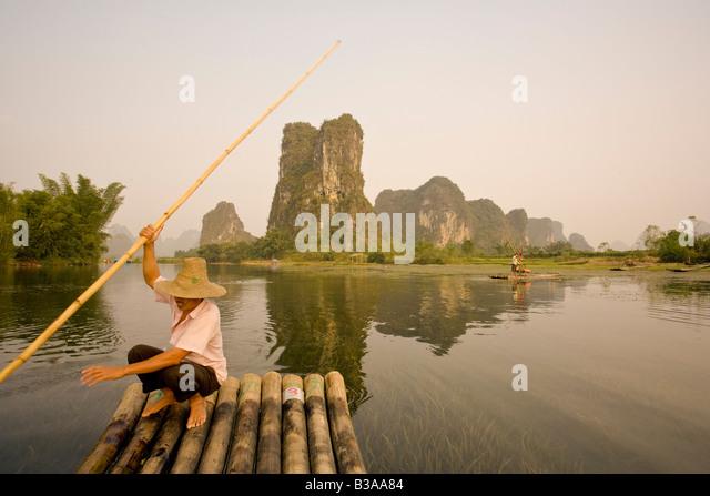 Bamboo raft along Yulong He River, Yangshuo, Guilin, Guanxi Province, China - Stock Image