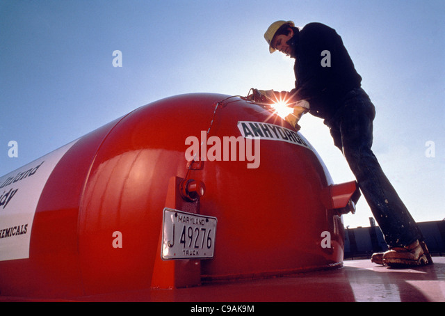 Worker at a distributor of solvents, chemicals and lubricants - Stock Image