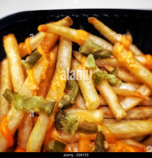 French fries with cheese and green chillies, served at Burger King, Dubai, UAE - Stock Image