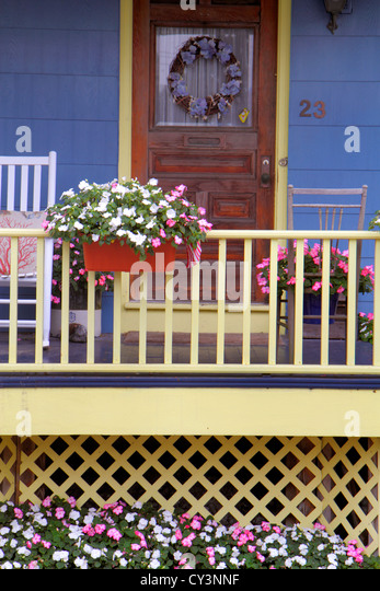 Rhode Island Newport John Street house home front porch flowers door Americana blue - Stock Image