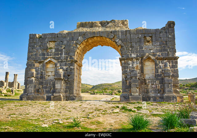 Roman ruins of Volubilis near Meknes, Triumphal Arch, UNESCO, Morocco, Africa - Stock Image