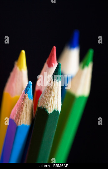 Color pencils on black background. Selective focus. - Stock-Bilder