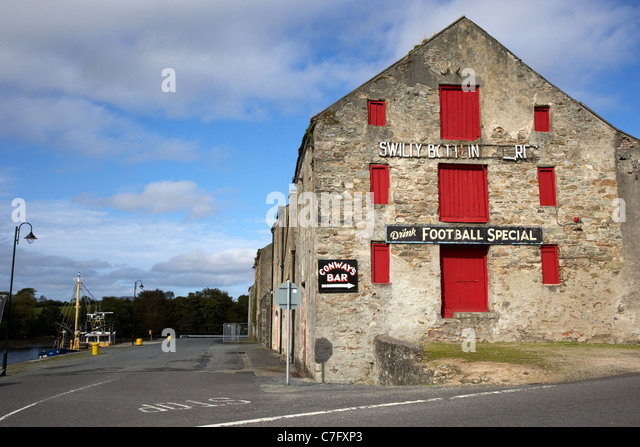 swilly bottling stores in the old warehouses on the quay ramelton county donegal republic of ireland - Stock Image