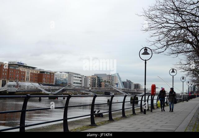 Seán O'Casey Bridge and Walk Path along The River Liffey in Dublin, Ireland - Stock Image