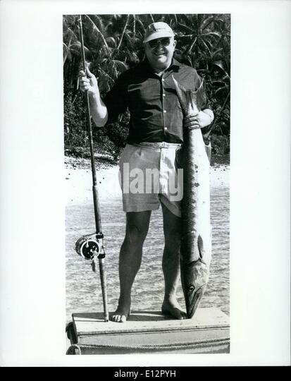 Feb. 25, 2012 - Good Start - -Jim Richards, Boston, Mass., decided to try his fishing luck in the Fiji islands. - Stock Image