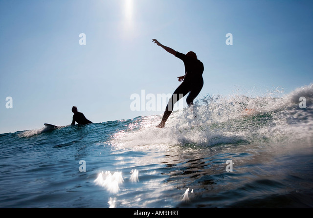 Two men surfing. - Stock Image