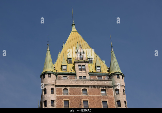 old historic quebec canada copper roof building french style architecture turrets towers windows - Stock Image