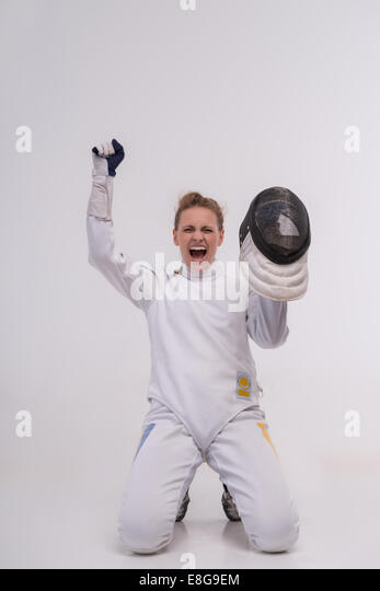 Young woman engaging in fencing - Stock Image