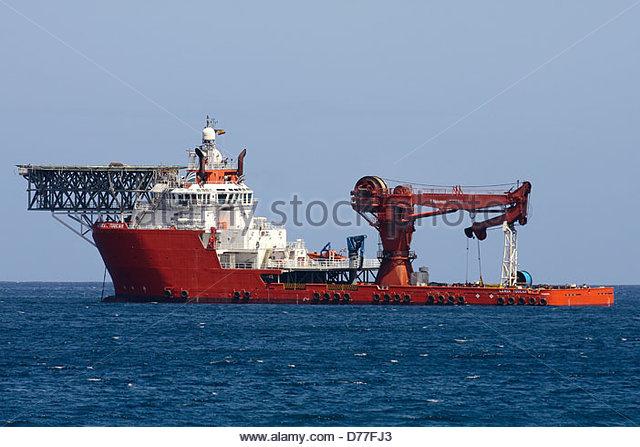 Lewek Toucan, an anchor handling vessel, moored. - Stock Image