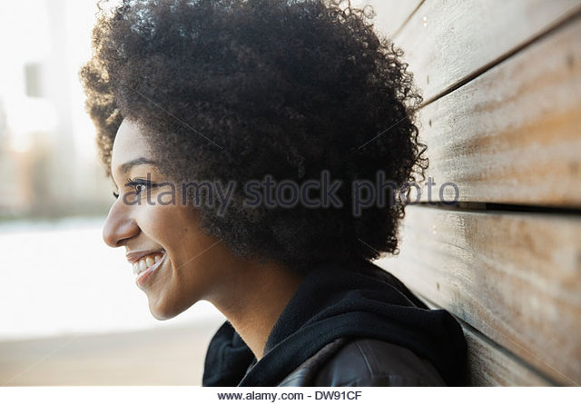 Side view of smiling woman outdoors - Stock-Bilder