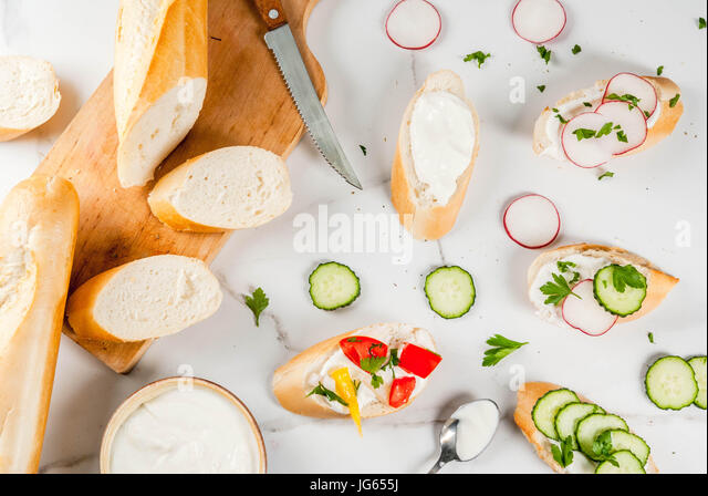 Healthy food. Spring, summer snacks. Sandwiches toast with homemade cream cheese and fresh vegetables - radish, - Stock Image