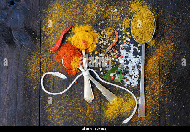 Healthy eating Background with herbs and spices selection on dark wooden table. Food or cooking concept, top view. - Stock Image