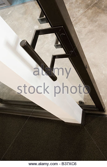 Detail of an glass door handle - Stock Image