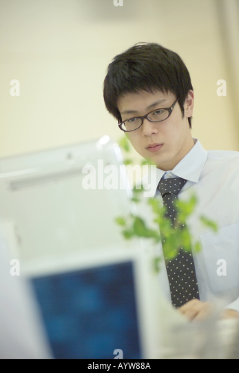 Office worker with a computer - Stock-Bilder