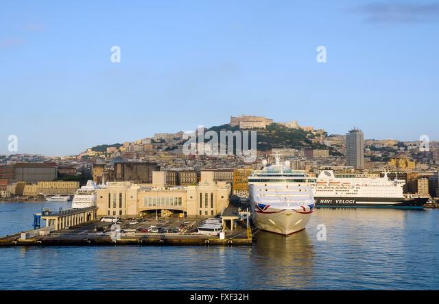 Cruise port terminal Naples, Italy, in early morning with Naples in background. - Stock Image