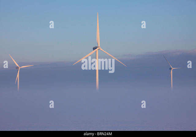 Fog around wind turbines, North Frisia, Schleswig-Holstein, Germany. - Stock Image