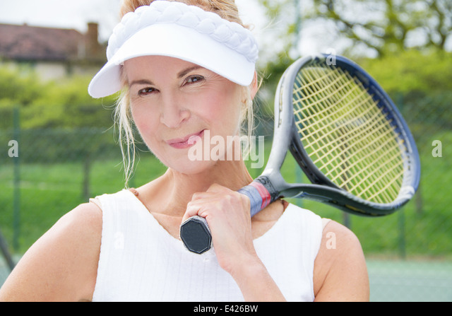 Close up portrait of mature female tennis player - Stock Image