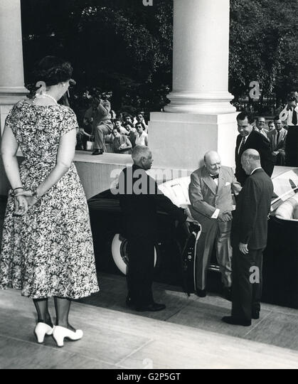 Mamie Eisenhower waits at the top of the steps as President Dwight Eisenhower greets Prime Minister Winston Churchill - Stock Image