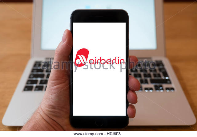 Using iPhone smart phone to display logo of AirBerlin low-cost airline - Stock Image