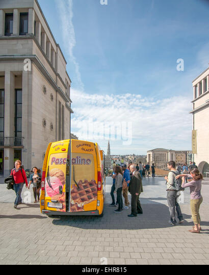 A line of people waiting at a waffles food truck in Brussels, Belgium. - Stock Image