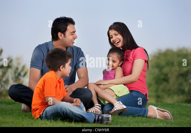 Family having fun in a park - Stock Image