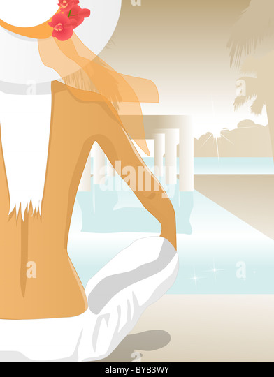 A woman sitting by a pool - Stock Image
