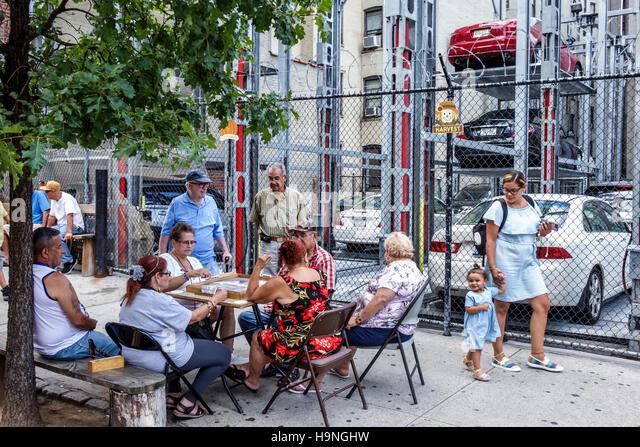 Manhattan New York City NYC NY East Harlem El Barrio Spanish Harlem immigrant neighborhood parking garage sidewalk - Stock Image