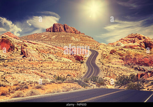 Retro stylized picture of a country road, travel concept, USA. - Stock-Bilder