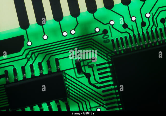 Computer technology concept - visual metaphor for electronics. Circuit board / pcb showing components backlit with - Stock Image