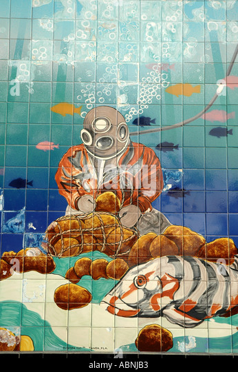 Tarpon Springs Florida Wall Tiles at the Sponge Exchange showing traditional sponge hard hat diver - Stock Image