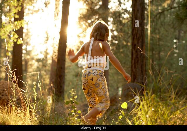 Girl walking in the woods - Stock-Bilder