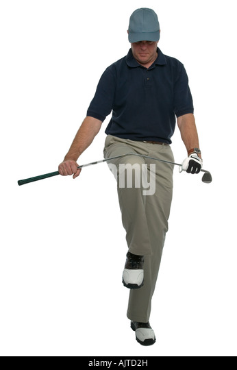 Angry golfer breaking a club over his knee - Stock Image